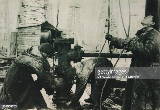 The preparation of a survey of an oilfield photo from L'illustrazione Italiana year LXII n 37 September 15 1935