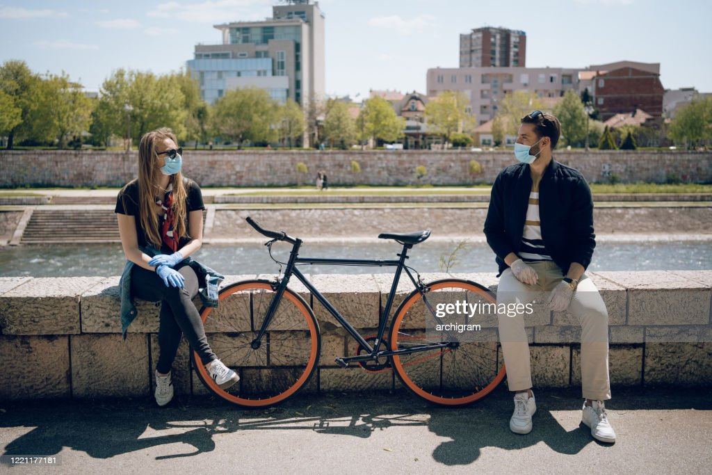 The prescribed measure of social distance is one bicycle : Stock Photo