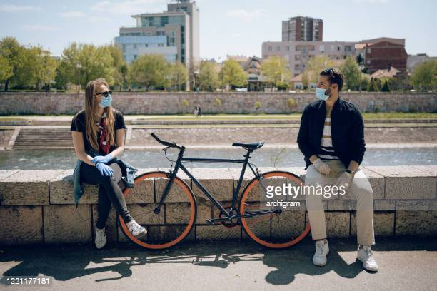 the prescribed measure of social distance is one bicycle - romance stock pictures, royalty-free photos & images