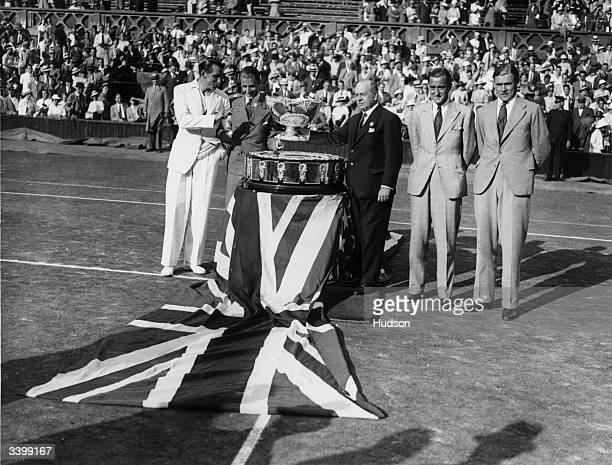 The presentation of the Davis Cup to the winning British team at Wimbledon Left to right Fred Perry Bunny Austin Henry Roper Barrett Pat Hughes and...