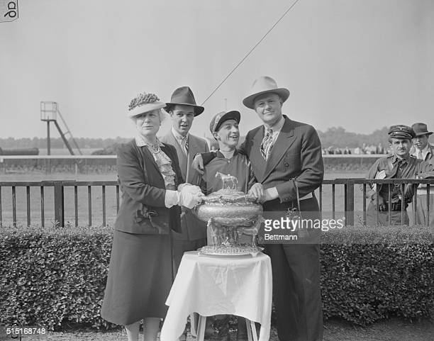 The presentation of the trophy after Calumet Farm's Whirlaway won the $25000 added Belmont Stakes adding that victory to the Kentucky Derby and...