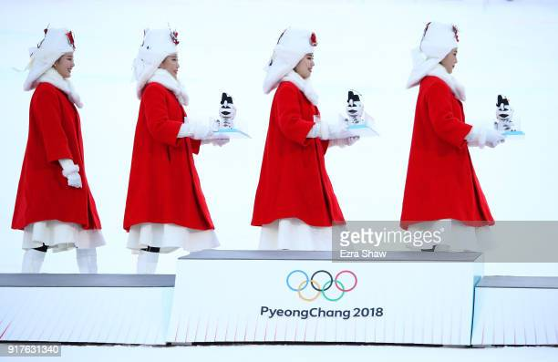 The presentation party enter the arena for the Men's Alpine Combined Slalom victory ceremony on day four of the PyeongChang 2018 Winter Olympic Games...