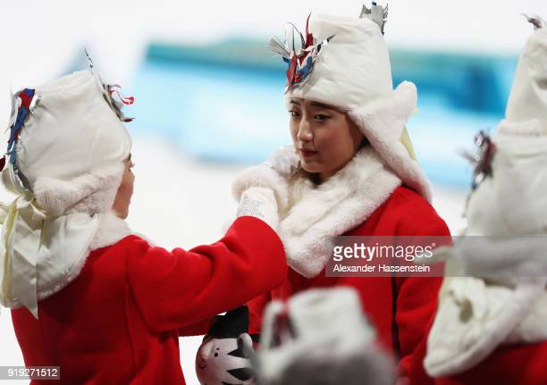 The presentation party prepare for the victory ceremony for the Women's 125km Mass Start Biathlon on day eight of the PyeongChang 2018 Winter Olympic...