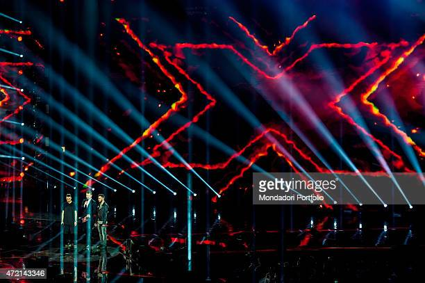 'The presenter Alessandro Cattelan with the singers Madh and Lorenzo Fragola during the final of the talent show X Factor Assago Italy 11th December...