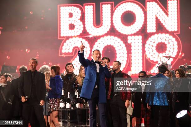 The presenter Amadeus seen surrounded by guests during the TV show 'The coming year' rai1 at The Piazza Vittorio Veneto in Matera Matera will become...
