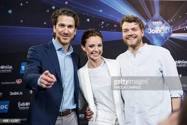 The presenters Danish musician Nikolaj Koppel Danish television presenter Lise Roenne and Danish actor Pilou Asbaek pose during a Meet and Greet on...