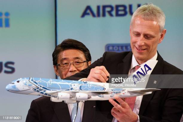 The President and CEO of ANA Holdings Inc Shinya Katanozaka and Rolls Royce President For Civil Aerospace Chris Cholerton attend a ceremony for the...