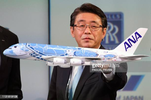 The President and CEO of ANA Holdings Inc Shinya Katanozaka attend a ceremony for the delivery of the first Airbus A380 to the Japanese airline All...