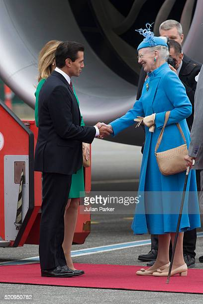 The President and his wife arrive at Copenhagen Airport at the start on their visit and greeted by Queen Margrethe of Denmark during the State visit...