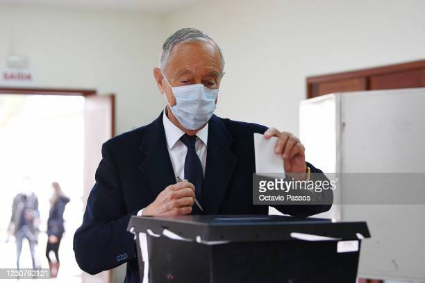 The President and independent candidate Marcelo Rebelo de Sousa holds his ballot prior to casting it at a polling station for the 2021 presidential...