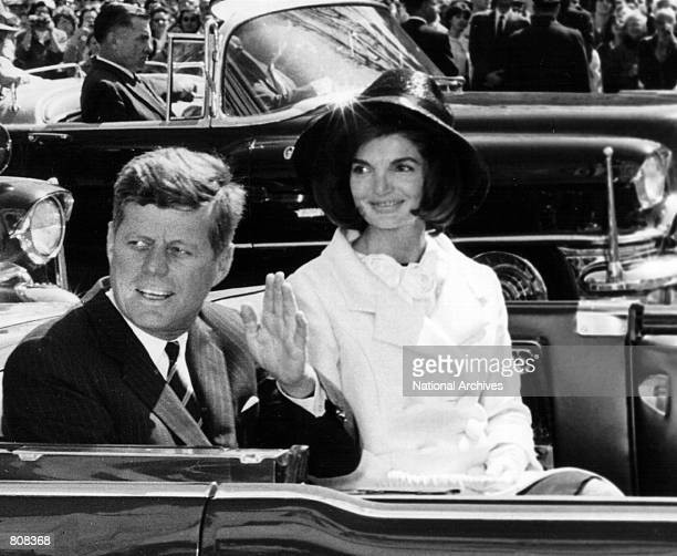 The President and Mrs Kennedy ride in a parade March 27 1963 in Washington