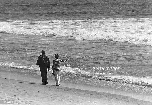 The President and Mrs. Nixon look at the ocean August 20, 1971 at a beach in San Clemente, CA.