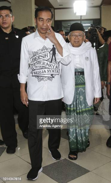 The president and vice president candidate of Indonesia Joko Widodo and Maruf Amin leave the General Elections Commission office after registering...