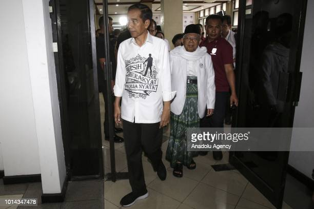 The president and vice president candidates of Indonesia Joko Widodo and Maruf Amin leave the General Elections Commission office after registering...