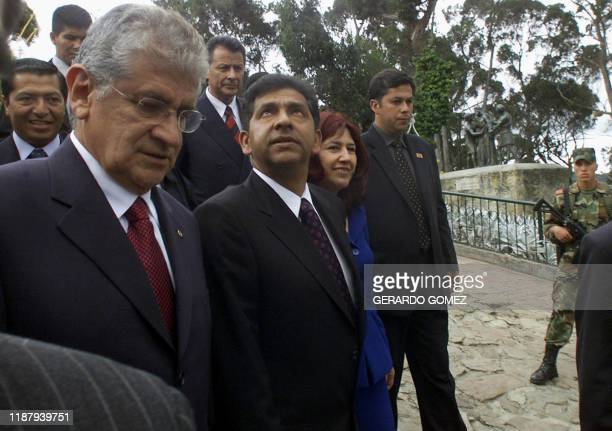 The president elect of Ecuador Lucio Gutierrez , walks next to his wife Ximean Bohoroquea and employees of the Ecuatorian embassy, in the hill of...