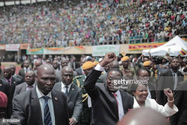 The president Emmerson Mnangagwa and his wife greet Zimbabweans during his inauguration ceremony as Zimbabwe's new president at the Harare...