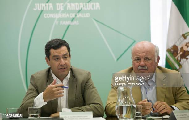 The president of Andalucía Juanma Moreno is seen next to the Health and Families Counsellor Jesús Aguirre presiding over the listeriosis outbreak...