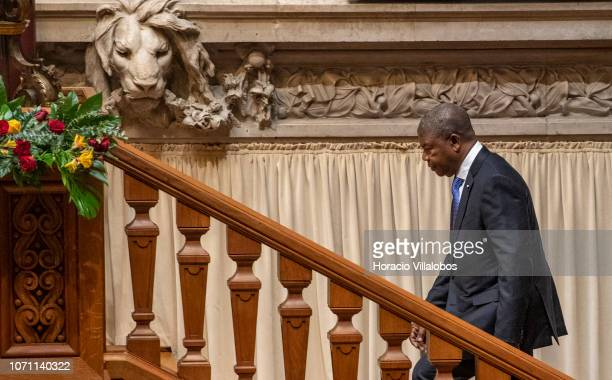The President of Angola João Lourenço enters to participate in a parliamentary plenary session in his honor on November 22, 2018 in Lisbon, Portugal....