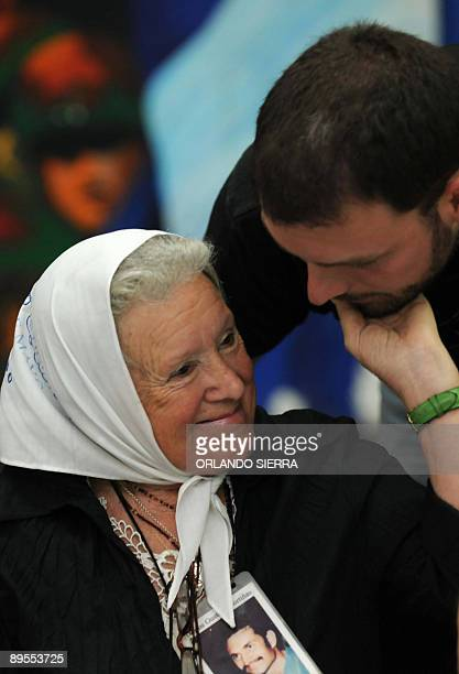 The president of Argentine human rights group Mothers of Plaza de Mayo Association Nora Cortiñas listens to an unidentified human rights activist...