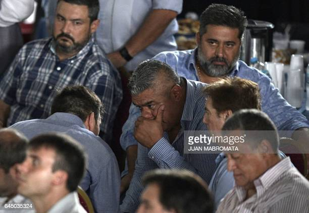 The president of Argentinian football team Barracas Central Claudio Tapia chats next to Boca Juniors' president Daniel Angelici during a meeting at...