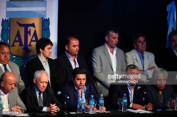 The president of Argentinian football team Barracas Central Claudio Tapia speaks next to Boca Juniors' president Daniel Angelici and Independiente's...