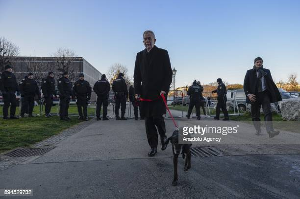 The President of Austria Alexander Van der Bellen walks with his dog ahead of the swearingin ceremony of the New Austrian Government at the Hofburg...