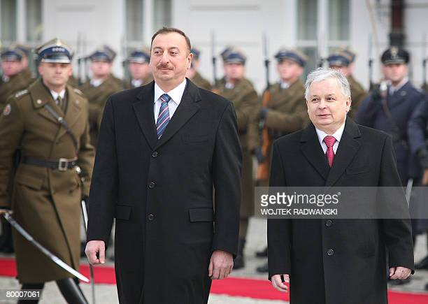 The President of Azerbaijan Ilham Alijev and his Polish counterpart Lech Kaczynski walk in front of an honour guard during an official welcoming...