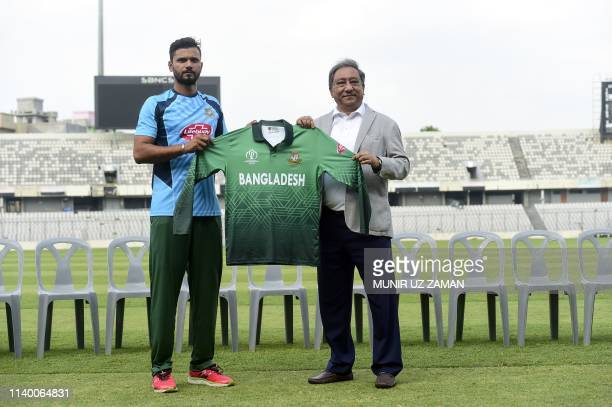 The president of Bangladesh Cricket Board Nazmul Hasan Papon and Bangladesh cricket team captain Mashrafe Bin Mortaza pose for photographs as they...