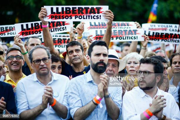 The president of Catalonia Quim Torra with ex President Artur Mas and the President of the Catalan Parliament Roger Torrent during the demonstration...