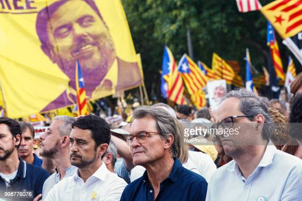The president of Catalonia Quim Torra with ex President Artur Mas in front of a banner claiming the freedom of Oriol Junqueras during the...