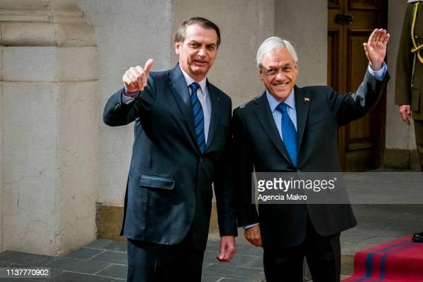 The President of Chile Sebastián Piñera and the President of Brazil Jair Bolsonaro greet the press at the Palacio de La Moneda on March 23 2019 in...