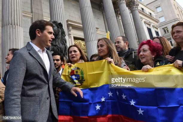 The president of Ciudadanos political party Albert Rivera seen greeting Venezuelans gathered in front of Congreso de los Diputados in Madrid during...