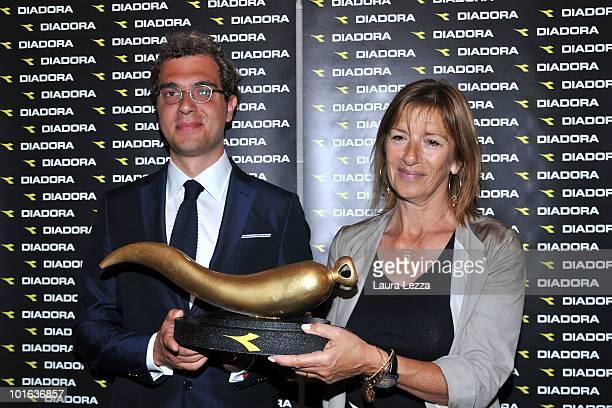 The president of Diadora Enrico Moretti Polegato gives a horn as good luck to Simonetta Lippi wife of the coach of Italian Nationa Football team...