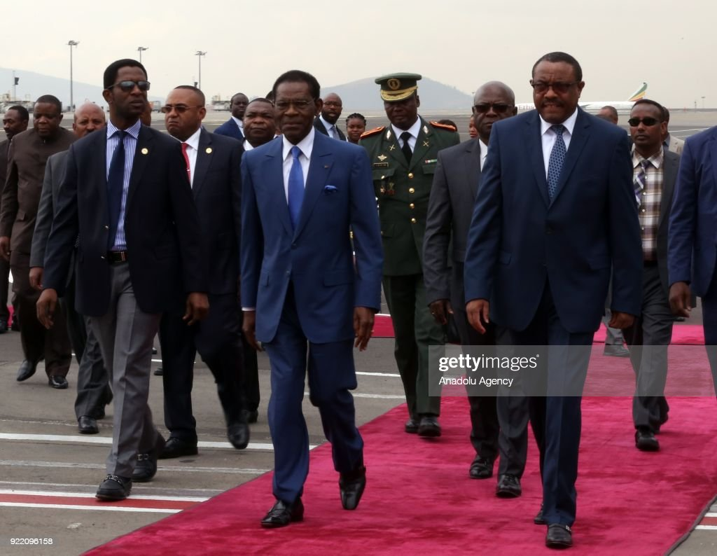The President of Equatorial Guinea, Teodoro Obiang Nguema (2nd L) is welcomed by Prime Minister of Ethiopia Hailemariam Desalegn (R) at Addis Ababa Bole International Airport in Addis Ababa, Ethiopia on February 21, 2018.