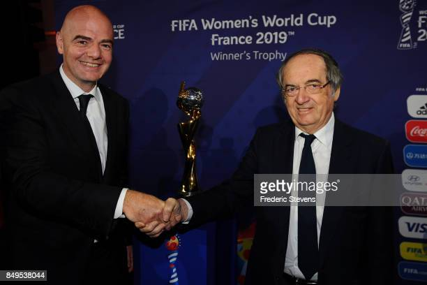 The president of FIFA Gianni Infantino shakes hands with Noel Le Graet President of the France Football Association during the Presentation World Cup...