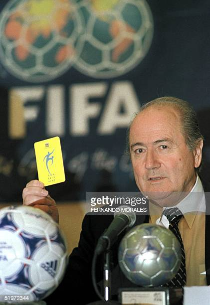 The President of FIFA Joseph Blatter shows a yellow card as he talks about to the violence in soccer during a press conference in Guatemala City 02...