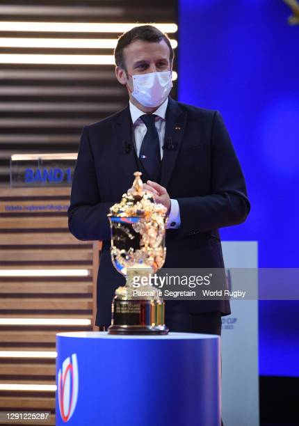 The President of France, Emmanuel Macron looks on as the Webb Ellis Cup is seen during the Rugby World Cup France 2023 draw at Palais Brongniart on...