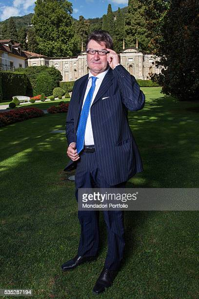 The president of Geox Mario Moretti Polegato wearing a pinstriped suit by Geox shoes by Geox Amphibiox and a tie by Marinella at the Forum Ambrosetti...