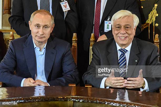The President of Greece Prokopis Pavlopoulos welcomes the president of the Russian Federation Vladimir Putin in Mount Athos Greece on May 28 2016