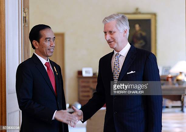 The President of Indonesia Joko Widodo shakes hands with King Philippe of Belgium prior to their meeting at the Royal Palace of Brussels, on April...