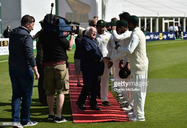 The President of Ireland Michael D Higgins greets the teams before the third day of the test cricket match between Ireland and Pakistan on May 13...