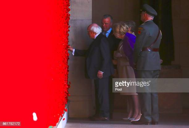 The President of Ireland Michael Higgins is watched by his wife Sabina Brendan Nelson Director of the Australian War Memorial and Frances Fitzgerald...