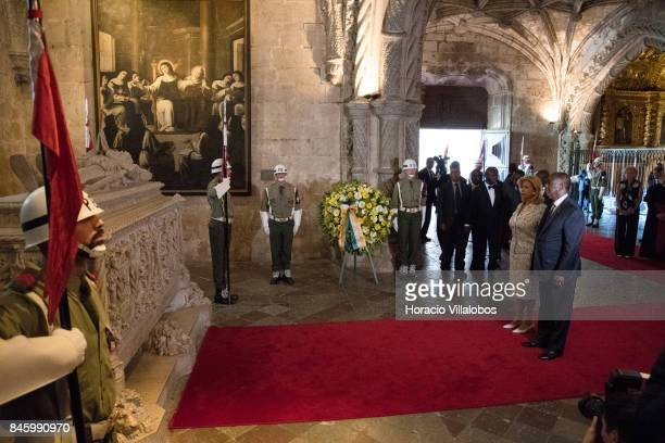 The President of Ivory Coast Alassane Dramane Ouattara and his wife Dominique Ouattara pay homage to Luis de Camoes Portugal's and the Portuguese...