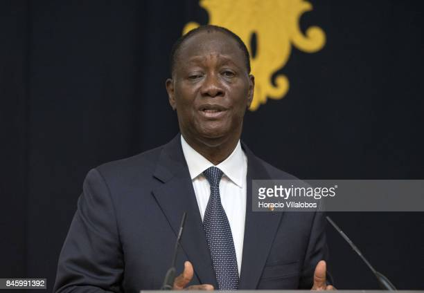 The President of Ivory Coast Alassane Dramane Ouattara delivers remarks to the press at the end of his meeting with Portuguese President Marcelo...