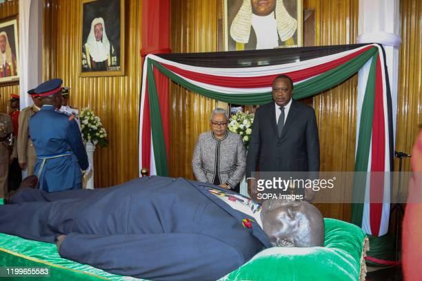 The president of Kenya Uhuru Kenyatta and his wife Margaret Kenyatta pay their last respect to the late Daniel Arap Moi at Parliament buildings The...