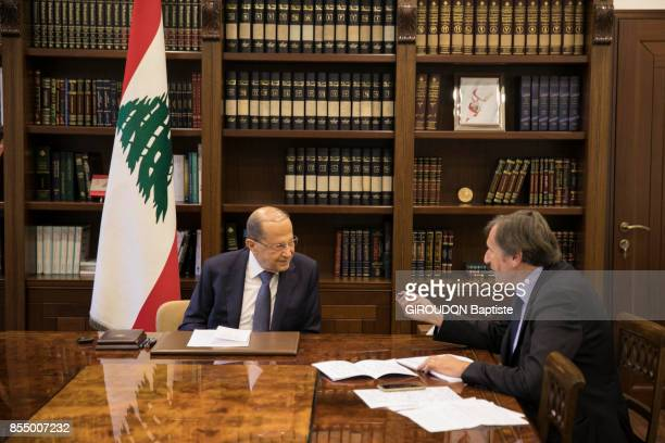 the President of Lebanon Michel Aoun with the writer Daniel Rondeau are photographed for Paris Match in his office of the Palais Baabda on september...