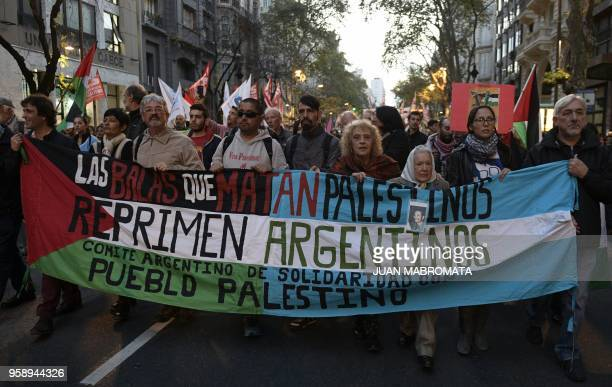 The president of Madres de Plaza de Mayo Linea Fundadora Nora Cortinas Protestors holds a PalestinianArgentine flag while heading to the Israel's...