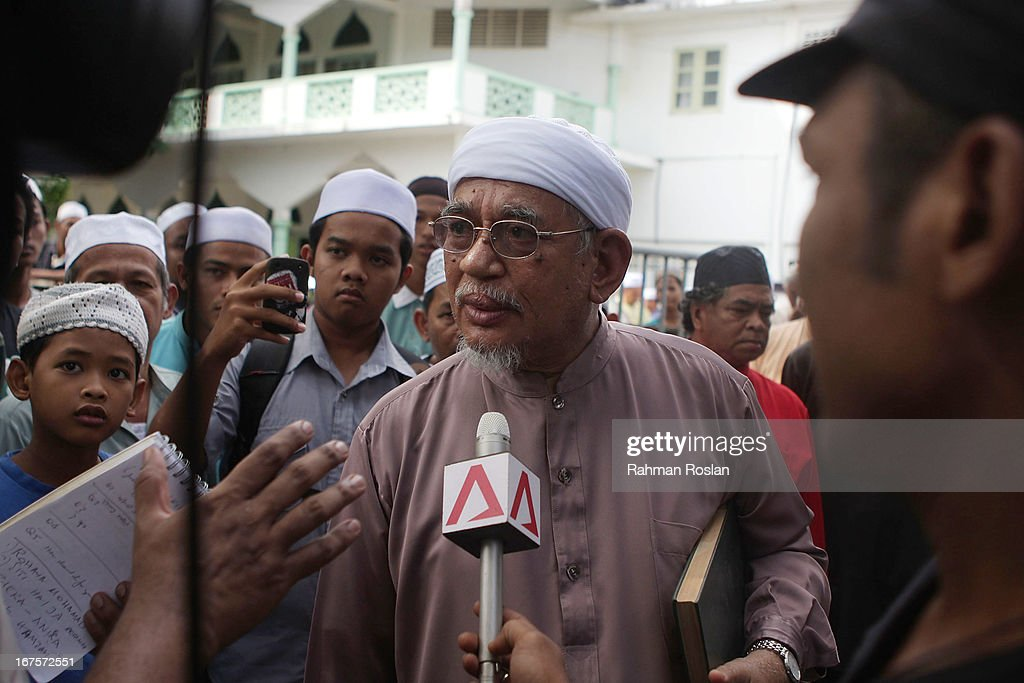 The president of Malaysian Pan Islamic Party, Abdul Hadi Awang answers questions during an interview in front of his home on April 26, 2013 in Rusila, Malaysia. Malaysia's 13th general election will be held on May 5.