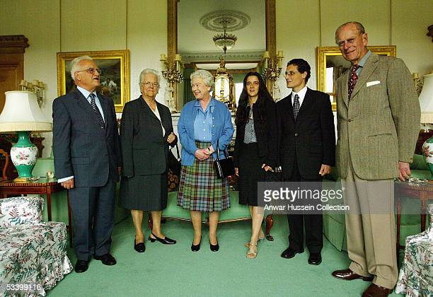 The President of Malta Dr Edward FenechAdami and his wife Mary stand with Britain's Queen Elizabeth II the daughter of the President Mrs Maria Cassar...