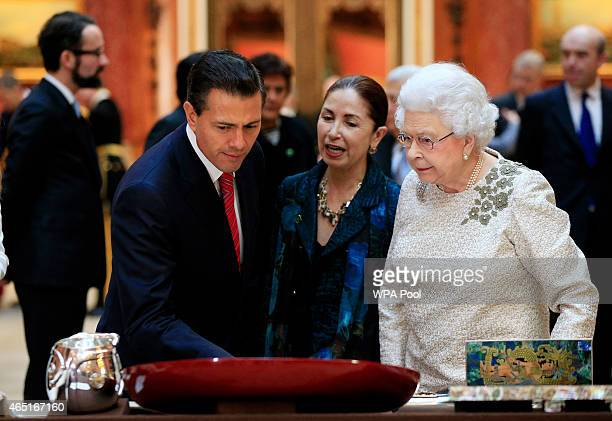 The President of Mexico Enrique Pena Nieto and Queen Elizabeth II view a display of Mexican items in the Royal Collection at Buckingham Palace on...